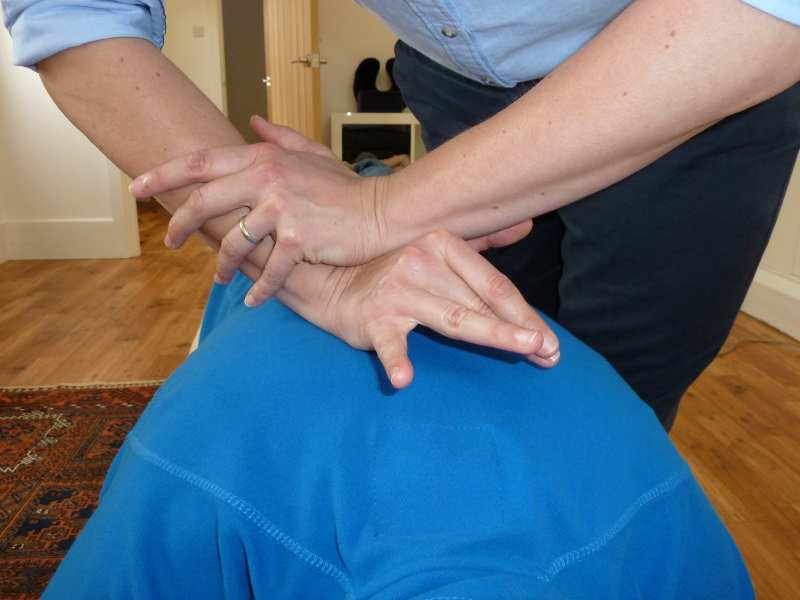 Close up of mid back chiropractor harrogate technique